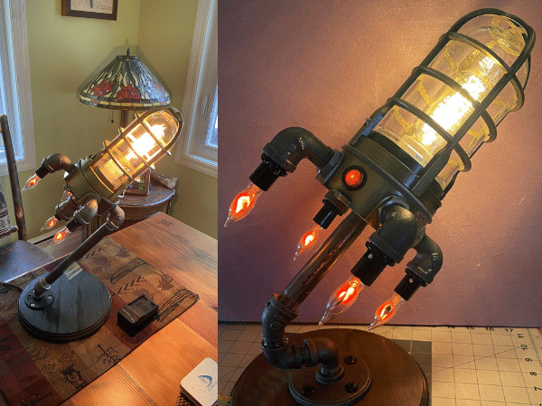 rocket ship lamp featured on a home desk