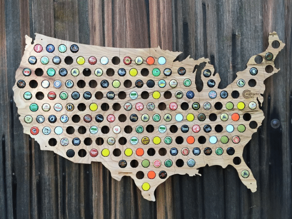 Bottle cap wall display hanging on a wooden wall