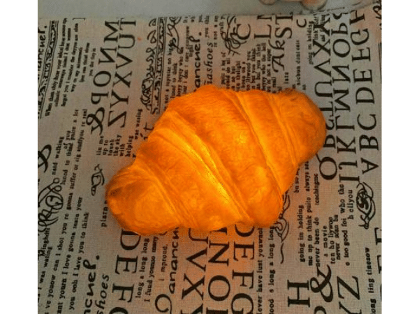 Crescent Roll Lamp sitting on paper