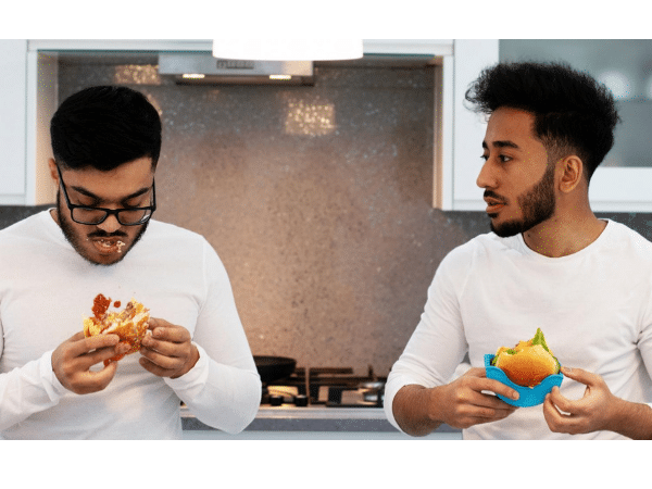 The founders and designers of Buddy Burger hamburger holder