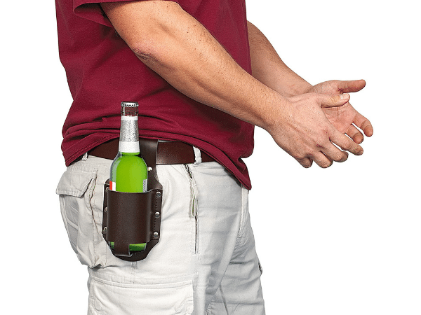 Guy holding his beer in a leather beer holster