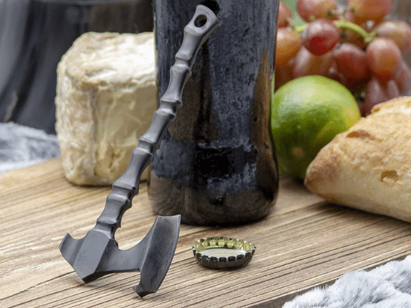 Stainless Steel Viking Axe Bottle Opener sitting on a table